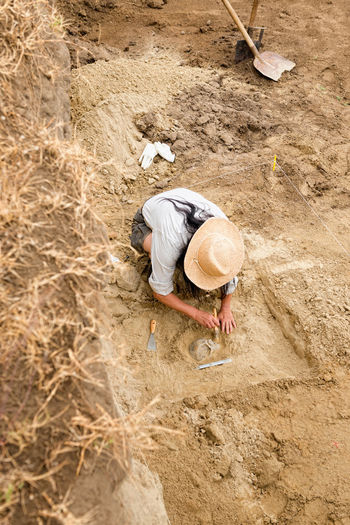 High angle view of woman working in dirt