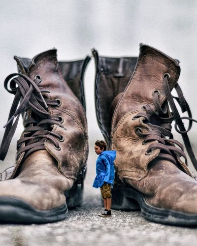 Big shoes to fill. Boots Real People Men Lifestyles Child People Childhood Shoe Boys Standing Casual Clothing Outdoors