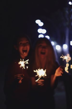 Adult Bonding Burning Celebration Couple - Relationship Emotion Glowing Happiness Holding Illuminated Lifestyles Males  Men Night People Positive Emotion Real People Smiling Sparkler Togetherness Two People Women Young Adult