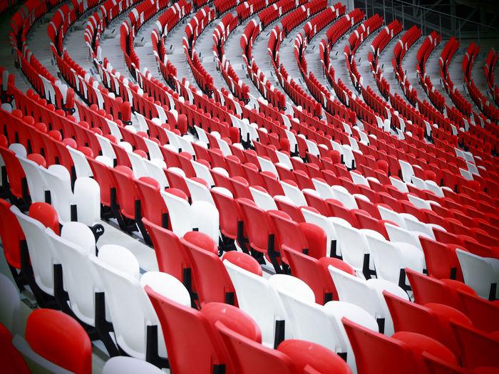 Empty Seats Arranged In Stadium