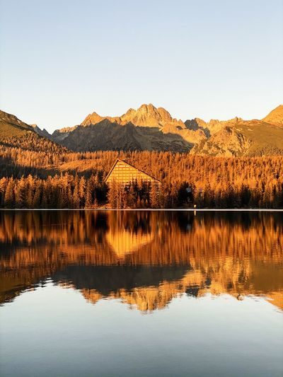 Scenic view over mountains and lake in autumn during sunset. slovakia, tatra mountains.
