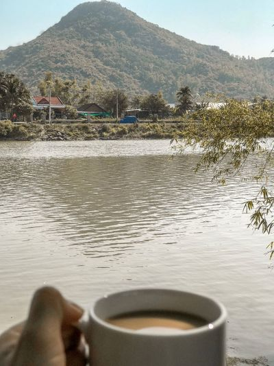 Village Non-urban Scene Sinrise Mug In Hand Holding Cup Cup Of Coffee Drinking River View River Morning Rituals Morning Food And Drink Refreshment One Person Drink Water Cup Mountain Real People Mug Lifestyles Human Body Part Lake Nature Human Hand Coffee Leisure Activity Unrecognizable Person Hand Body Part