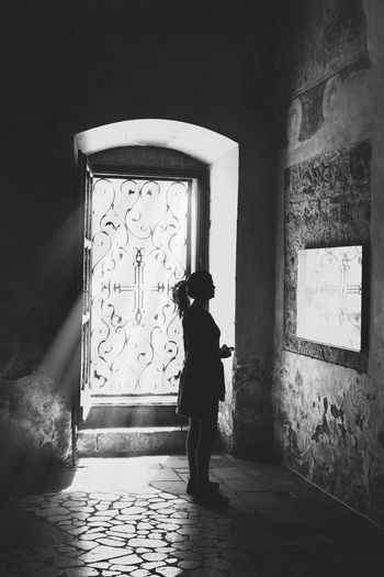 Girl standing inside Novo Hopovo monastery, reading text on the wall Damaged Architecture GOD Bless You Jesus Christ Light Coming Through Monastery Monastery Of Stone Orthodox Church Religious Art Shadows & Lights Tradition Ancient Architecture Black And White Photography Church Architecture Fresco Paintings Girl Alone With Her Thoughts Girl Reading Light Rays Penetrating Prays Relligion Stone Architecture Stone Floor