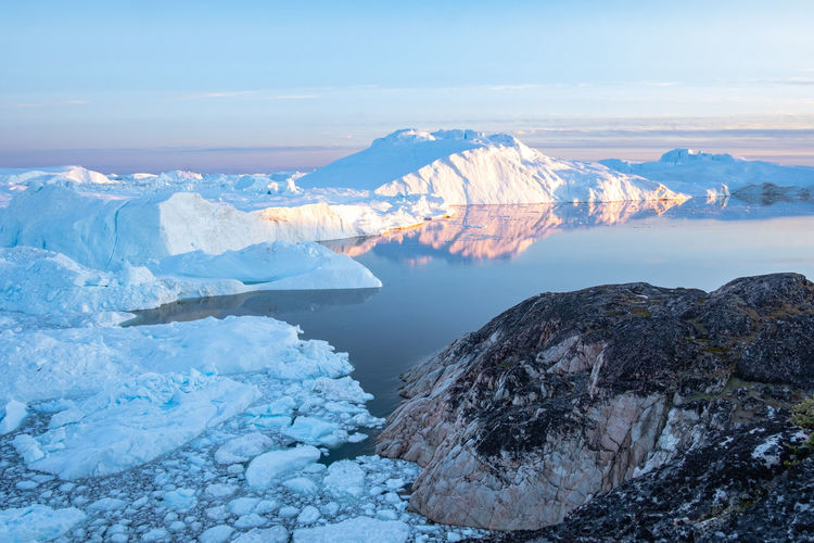 High angle view of ice berg in sea during winter