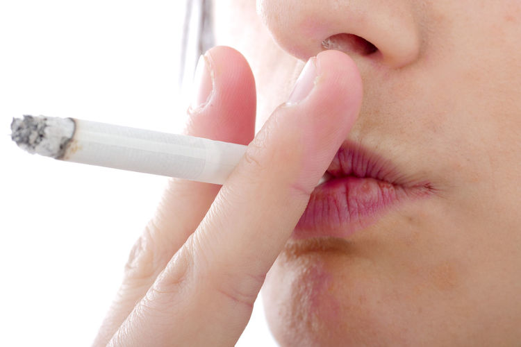 Human Body Part Smoking Issues Close-up Bad Habit Cigarette  Social Issues Human Hand One Person Indoors  Body Part Human Mouth Holding Warning Sign Smoking - Activity Lifestyles Sign Hand Human Lips Mouth Open Human Face Finger