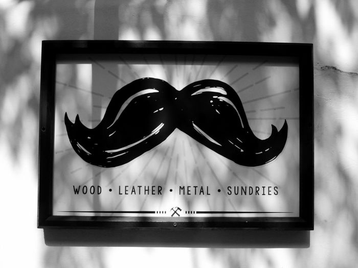 St. Augustine Sign Mustache Walking Around Town