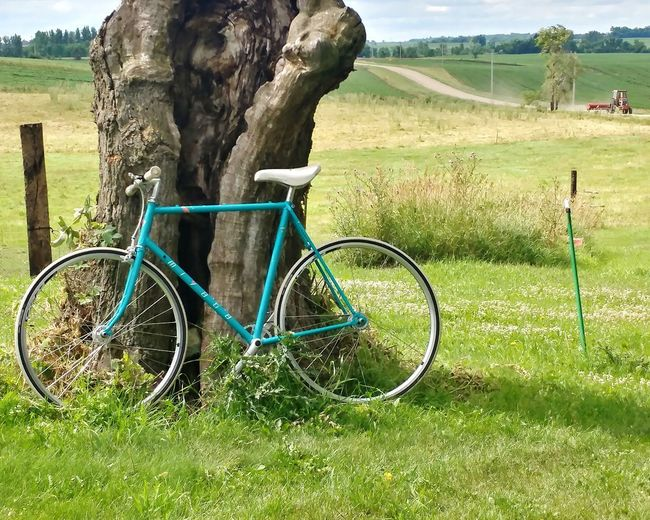 Bicycle parked on field