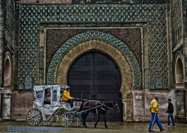 Adventures In The City Meknès People Building The Past Door Creativity Full Length Art And Craft Real People Architecture Arch Men Entrance Built Structure Ornate History Outdoors Building Exterior Day Morocco 🇲🇦 Tranquility Rainy Day Going Remote