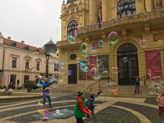 City Life Bubble Bubble Play Bubbles Bubbles In The Sky Built Structure Celebration City City Life Day Flags Fun In The City Hungarian Flag Hungary Kids Having Fun Kids Playing People Playing Kids Real People Street Life Travel Destinations