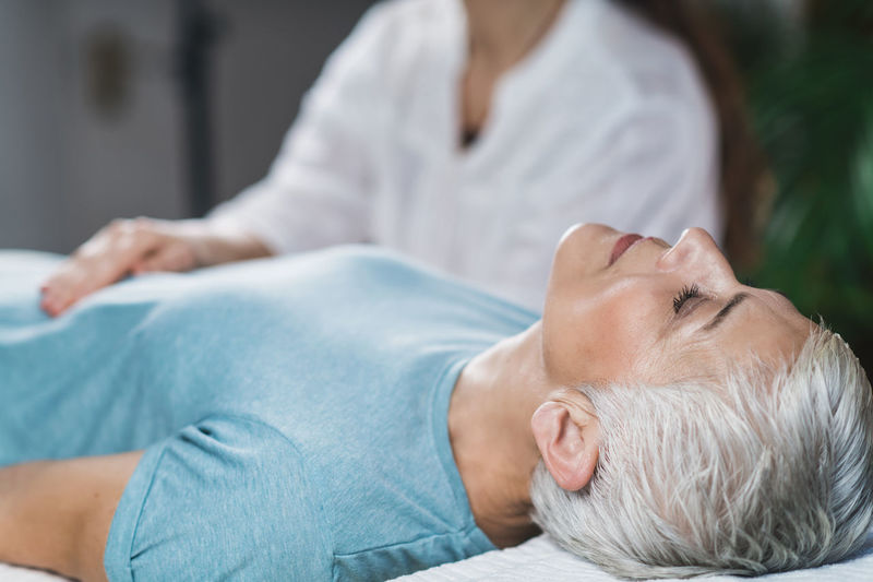 Close-up of woman getting massage at spa