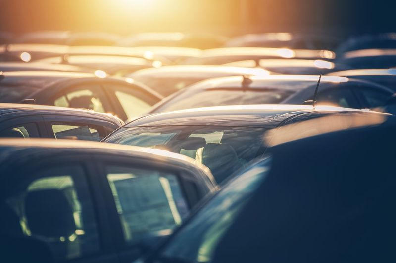 Close-up of cars during sunset