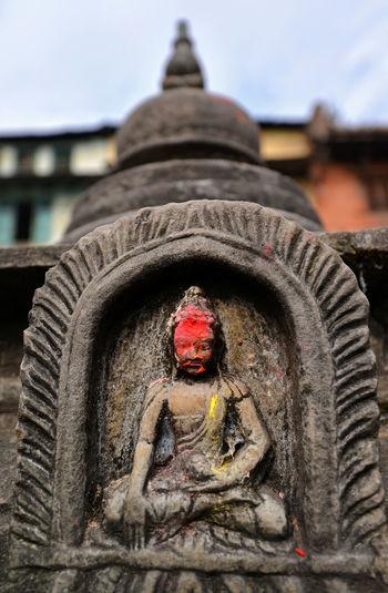 Miniature statue of a sitting Buddha in Swayambhunath. Kathmandu, Nepal Buddha Buddhist God Kathmandu Kathmandu, Nepal Nepal Statue Worship Architecture Buddha Statue Buddhism Buddhist Temple Close-up Landmark Praying Religion Sitting Buddha Small Statue Statue Statuette Staue  Stone Stone Statue Swayambhunath Tibetan