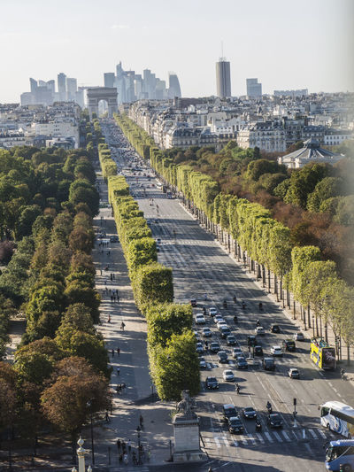 Vehicles on champs-elysees toward arc de triomphe in city