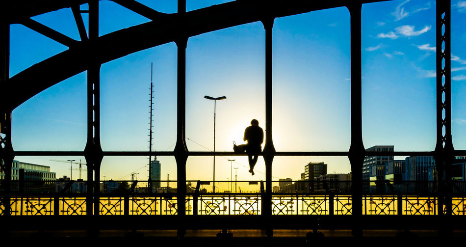 Architecture Summer Sunset Lonely Alone Bridge Sitting Reflecting Lifestyle Silhouette Sunlight End Of The Day Man Sunset Silhouettes Adult Sunset_collection Hackerbrücke One Person Built_Structure Silhoutte Photography Leisure Activity Built Structure Bridge - Man Made Structure Krull&Krull Images 50 Ways Of Seeing: Gratitude Humanity Meets Technology My Best Photo
