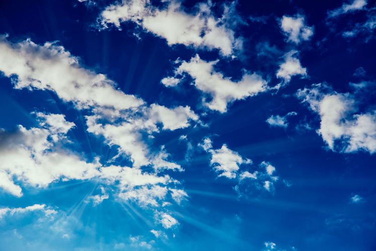 Deep blue sky with white clouds and sun rays Cloud - Sky Sky Beauty In Nature Blue Tranquility Low Angle View Scenics - Nature No People Nature Tranquil Scene Backgrounds Day Outdoors Idyllic Full Frame White Color Cloudscape Non-urban Scene Sunlight Meteorology