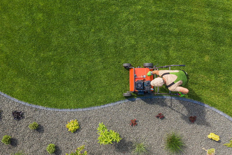 High angle view of tractor on grassy field