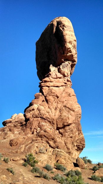 #arches #nationalpark #redrock #Utah Beauty In Nature Blue Clear Sky Cliff Copy Space Eroded Geology Landscape Low Angle View Nature Outdoors Physical Geography Rock Rock - Object Rock Formation Rocky Rough Scenics Textured  Tranquil Scene Tranquility