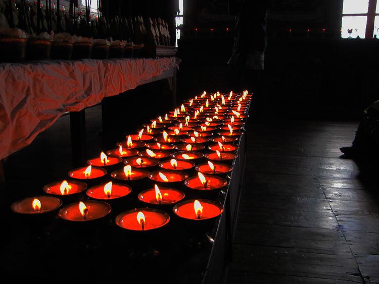 Burning candle-lamps in Tawang Monastery. Arunachal Pradesh ASIA Buddhism Burning Burning Diya Flame Illuminated India Indoors  Lamp Light Monastery Religion Religious  Tawang Tradition