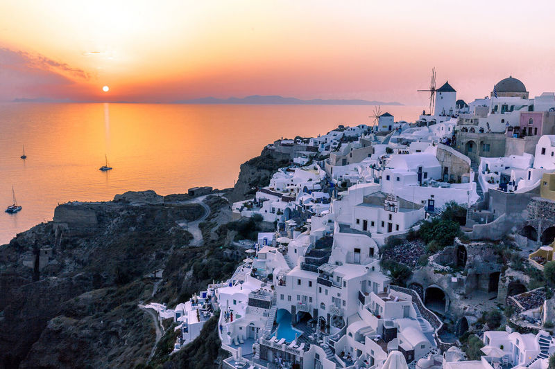 Houses By Sea During Sunset At Santorini