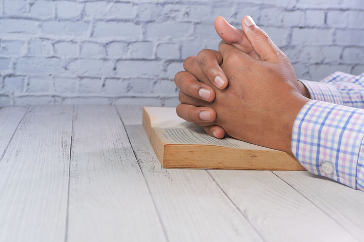 Close-up of man hand on table