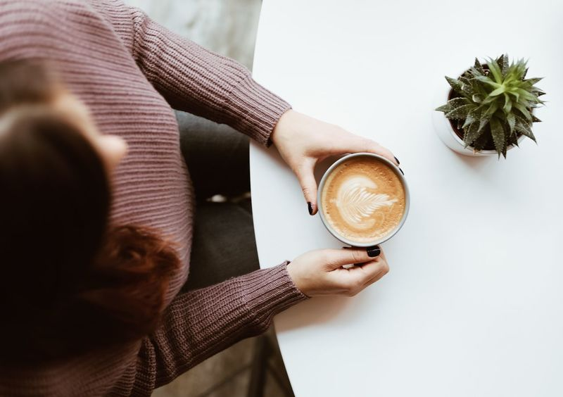 Coffee time // Food And Drink Drink Coffee - Drink Refreshment Table One Person Holding Coffee Cup Indoors  Freshness Leisure Activity Healthy Lifestyle Midsection Women Frothy Drink Real People Froth Art Drinking Glass Only Women Latte