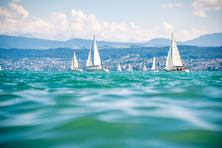 Sailboats on beautiful lake zürich zürichsee in switzerland.