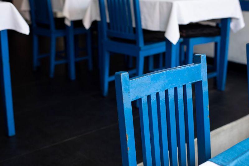 blue chsir in greek restaurant, Bali Restaurant Scene Seminyak Bali Eyem Collection Eyem Best Shots Eyemphotography Blue Seat Chair No People Focus On Foreground Wood - Material Empty Absence Indoors  Furniture