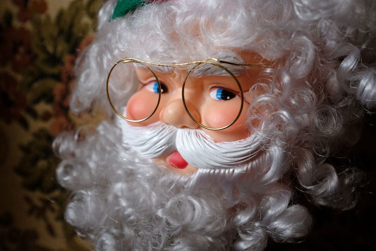 Santa Claus doll with rubber face and eyeglasses. Childhood Christmas Close-up Color Doll Eyeglasses  Face Indoors  Puppet Santa Claus Santa Claus Doll Santa Claus Puppet Still Life