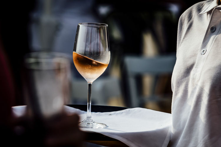 Close-up of wine glass on table in restaurant