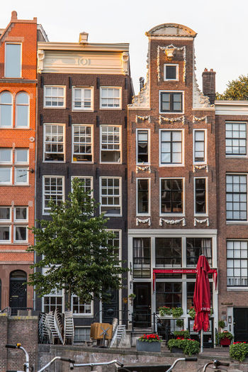 Amsterdam Netherlands Prinsengracht Architecture Building Building Exterior Built Structure Canal Houses City Communication Day Dutch Houses Glass - Material Holland Nature No People Outdoors Plant Residential District Sky Standing Street Tourist Destination Tree Window