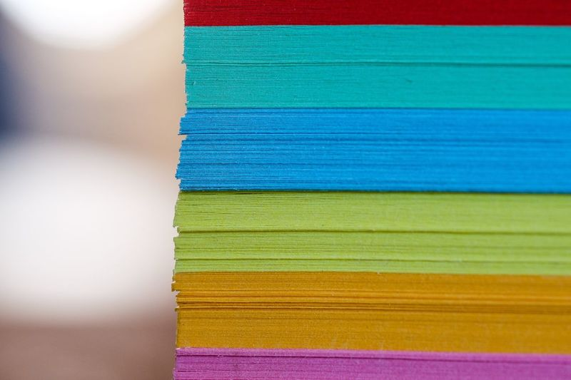 Close-up of stacked colorful adhesive notes