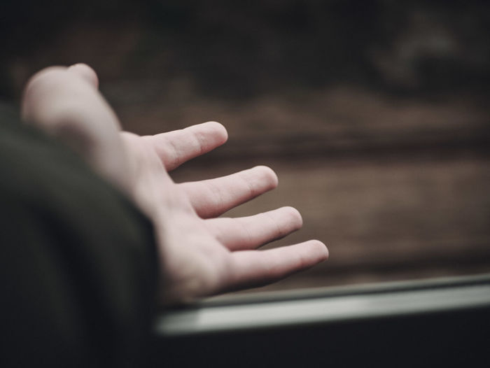 Close-up of man  hand in a train