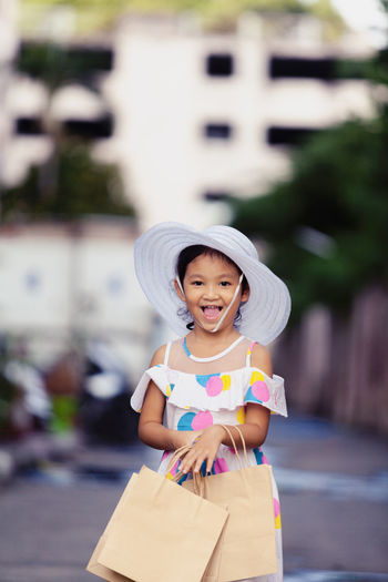 Portrait of cute girl standing outdoors