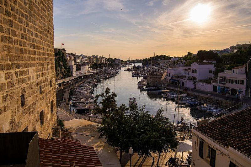 citadella, manorca,spain Travel Travel Destinations Sunset Bestsunset Ig_europa Explore Color Landscape Sunset_hub Igs_europe Igers Igersoftheday City Water Politics And Government Sunset Cityscape Tree Sky Architecture Building Exterior Built Structure Panoramic Old Town Calm