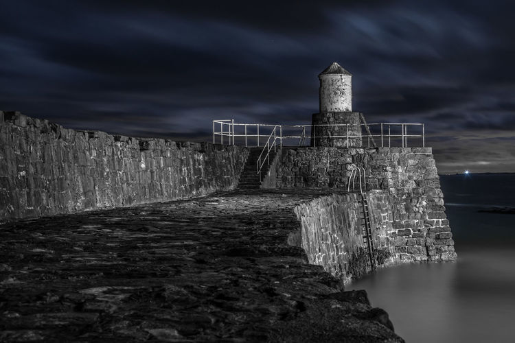 Pittenweem Lighthouse Harbour Lighthouse Moody Sky Atmospheric Mood Nikon Nikon D7200 Sea Wall Storm Architecture Built Structure Cloud - Sky Light And Shadow Longexposure Moodysky Nature No People Outdoors Pittenweem Sky Water