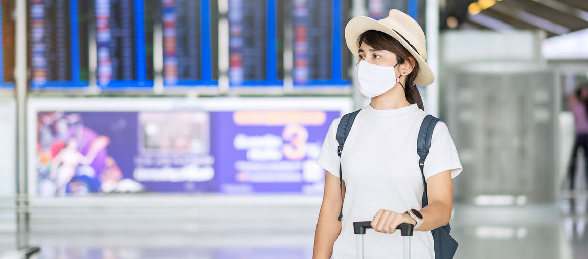 Beautiful woman with mask in airport