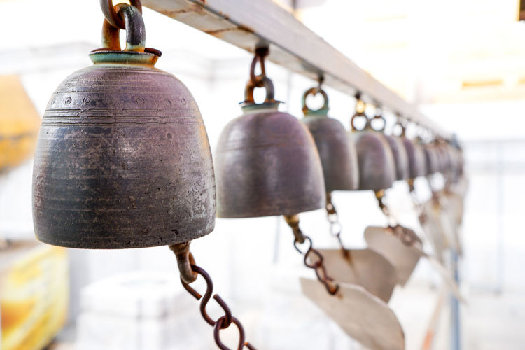 Close-up of bells hanging