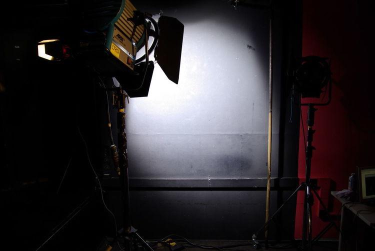 Spotlight in dark studio