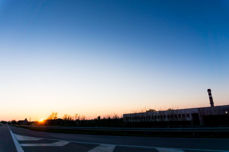 Beautiful sunset driving on the road Architecture Building Exterior Clear Sky Copy Space Day Driving Illuminated No People On The Road Outdoors Road Road Sky Sunset Sunset_collection Transportation
