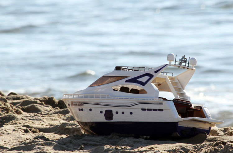 Children Beach Beauty In Nature Boat Child Day For Children Holiday Background Horizon Over Water Mode Of Transport Moored Nature Nautical Vessel No People Outdoors Sand Sea Sea Background Sky Toy Toy Boat Transportation Water