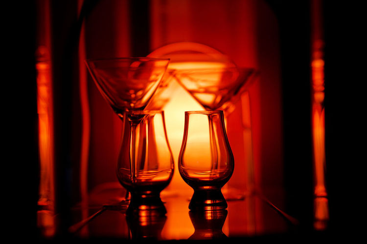 Back lit glasses Glass Glass - Material Transparent Drinking Glass Food And Drink Indoors  No People Household Equipment Close-up Red Still Life Illuminated Nightlife Martini Glass Orange Color