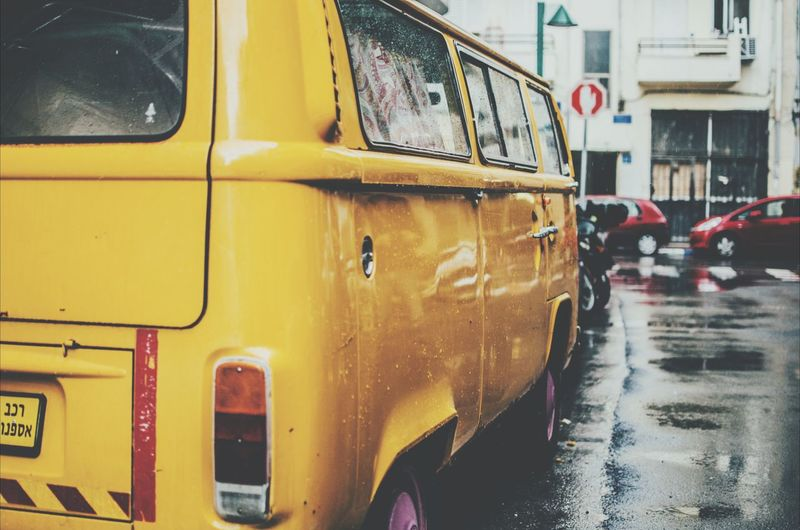 Cropped Shot Of Yellow Camper Van On Street