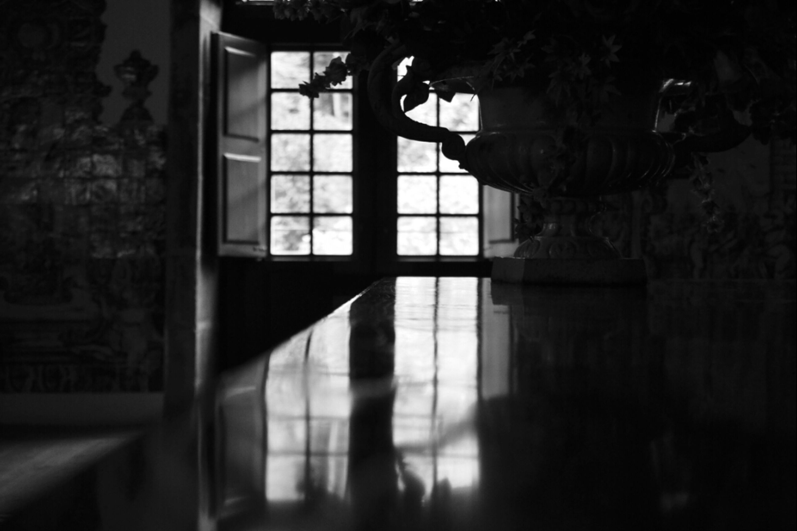 indoors, window, silhouette, shadow, lifestyles, dark, architecture, built structure, wall - building feature, standing, sunlight, home interior, men, flooring, leisure activity, glass - material, person, illuminated