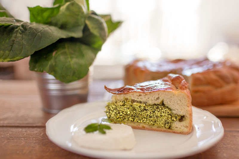 Close-up of spanakopita in plate on table