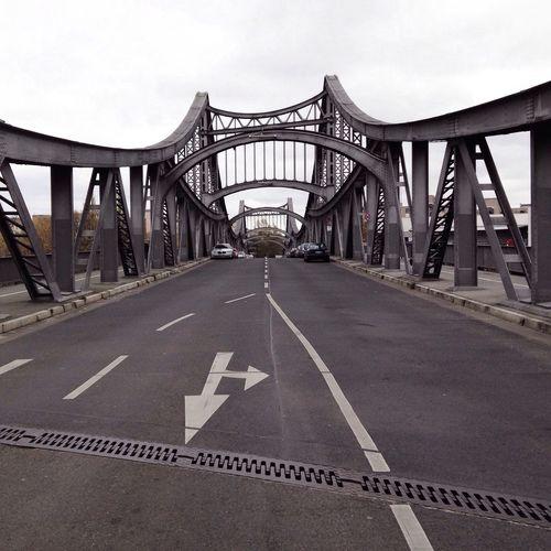 Empty road with bridge in background