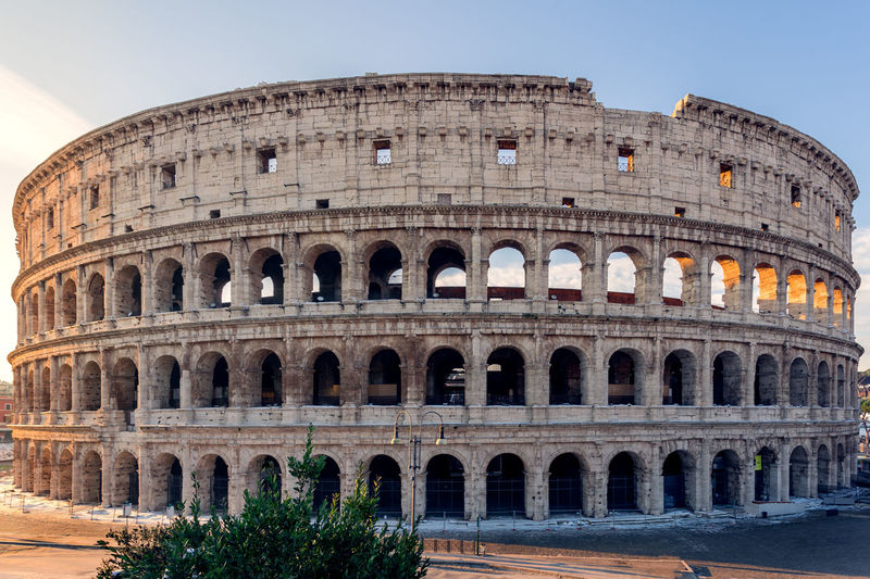 Colosseum during Sunrise in Winter. Amphitheater Ancient Ancient Civilization Arch Architecture Building Exterior Built Structure Clear Sky Day History Low Angle View No People Old Ruin Outdoors Sky The Past Tourism Travel Travel Destinations Tree