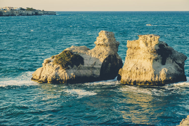 Two Sisters - Melendugno - Lecce - Italy Beach Beachphotography Beauty In Nature Coast Day Horizon Over Water Italy Lecce Nature Outdoors Rocks Rocks And Water Rocks In Water Salento Salento Puglia Scenics Sea Sea View Tranquil Scene Tranquility Travel Travel Destinations Travel Photography Traveling Water