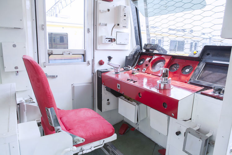 Empty seats in front of dashboard of locomotive