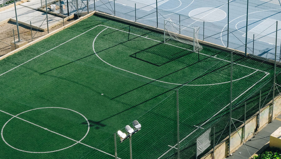 Sport Court High Angle View Green Color Day Built Structure Architecture No People Net - Sports Equipment Outdoors Absence Empty Grass Soccer Pattern Soccer Field Stadium Team Sport Nature Playing Field