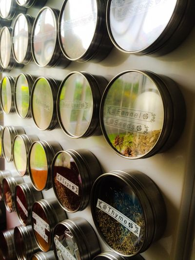 Close-Up Of Spices And Herbs With Labels At Rack